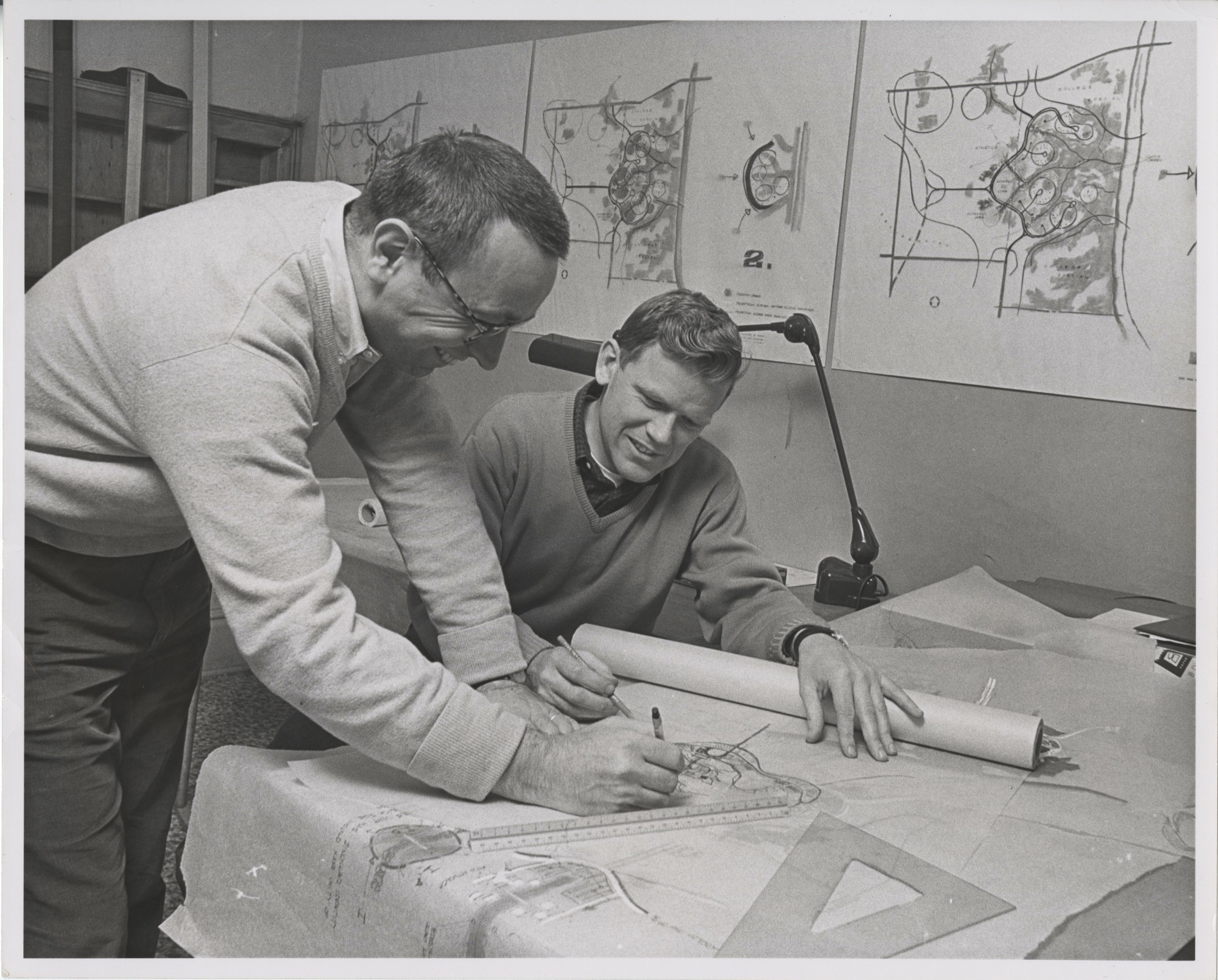 Architects from the firm of Meathe, Kessler & Associates study plans for Grand Valley State College's Allendale campus, ca. 1960.